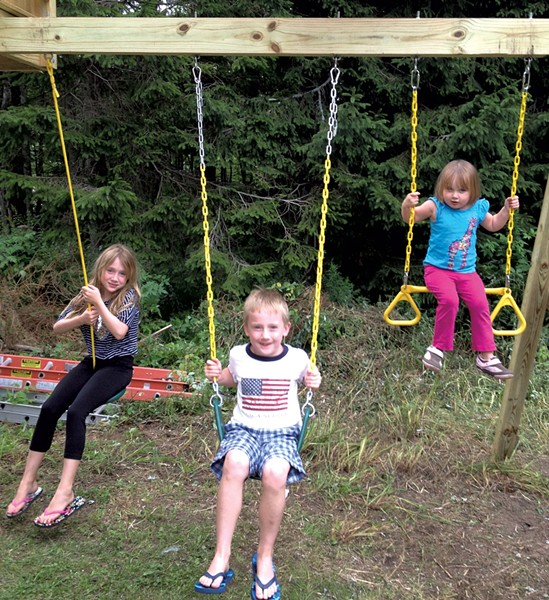The Harle children on the attached swingset - COURTESY OF RICHARD HARLE