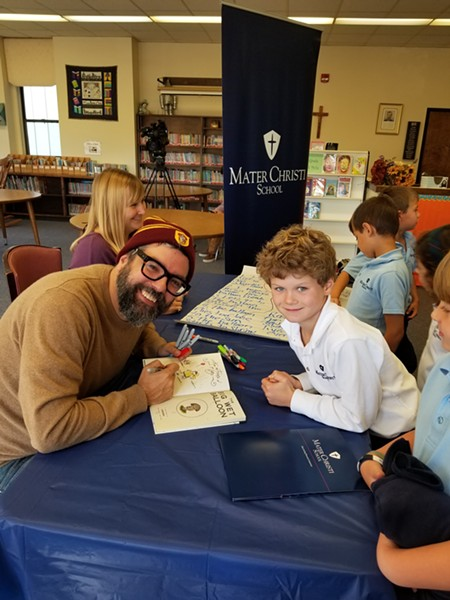 Liniers signs books at Mater Christi School - COURTESY OF MATER CHRISTI SCHOOL