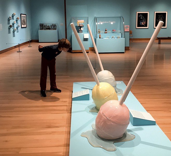 Theo checks out giant lollipops by conceptual artist Desire Obtain Cherish - COURTESY OF ALISON NOVAK