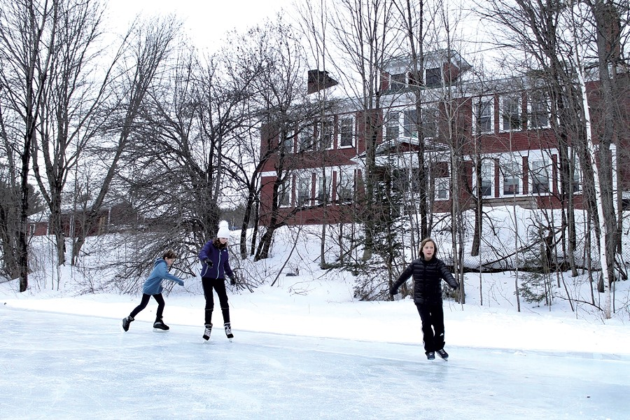 Skaters glide in the shadow of Woodbury Elementary School - MOLLY STANCIU