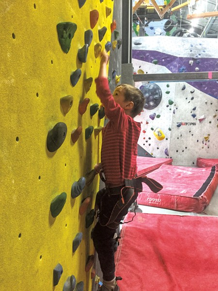 Luke scales the traverse wall - LIZ CADY
