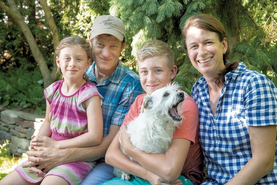 Mavis, Nate, Sawyer and Stacy with their dog, Fergus - JAMES BUCK