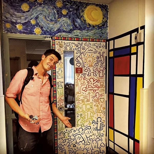 Pete Boardman in front of his classroom door