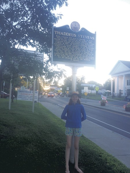 Somerset Pierce visiting the Thaddeus Stevens historical marker, on Vermont's African-American Heritage Trail (Activity 9)