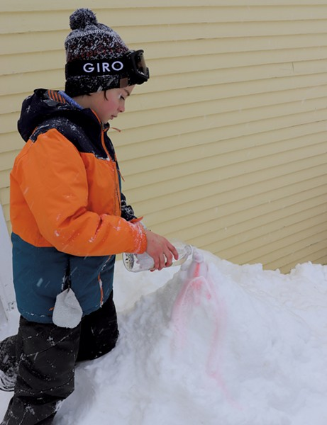 Zac erupts a snow volcano - COURTESY OF JANET FRANZ