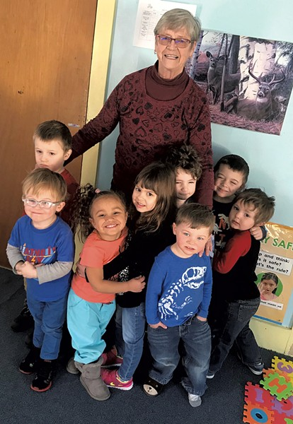 Judy Pransky, owner of Cherry Street PlayCare in St. Johnsbury, with children from the center - COURTESY OF JUDY PRANSKY