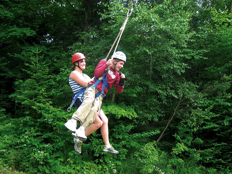 Former Partners in Adventure staff member Sarah and camper Chris swing together at Bolton Adventure Center - COURTESY OF DEBBIE LAMDEN