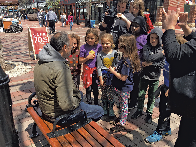 Newspaper staffers from George Leal's second grade class at the Integrated Arts Academy interviewing bystanders on Church Street after a flash mob featuring fellow students - COURTESY OF BURLINGTON SCHOOL DISTRICT