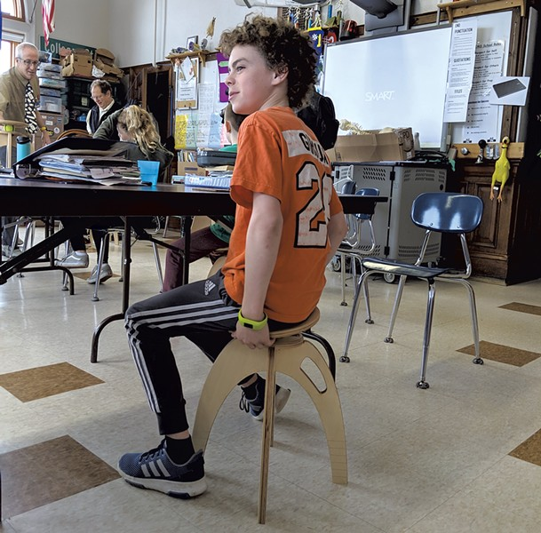A student at Edmunds Middle School tries the ButtOn Chair - COURTESY OF QOR360