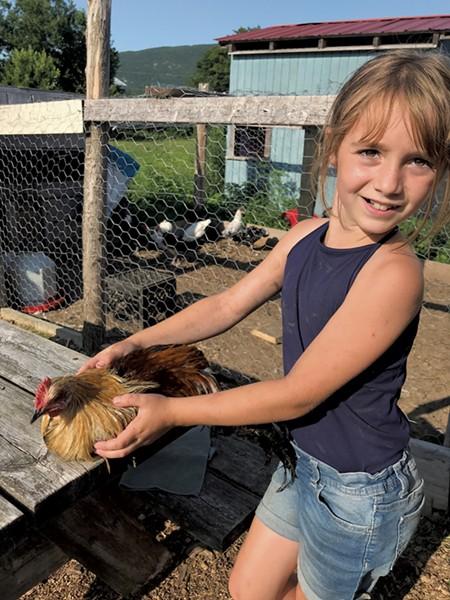 Natalie with Coco the chicken - BRETT ANN STANCIU