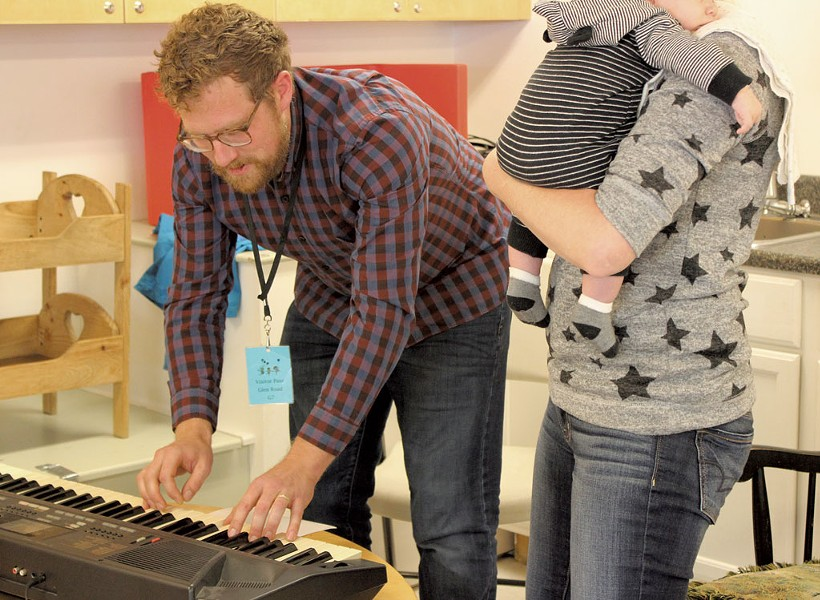 Evan Premo helps a mother compose a lullaby - COURTESY OF LUND