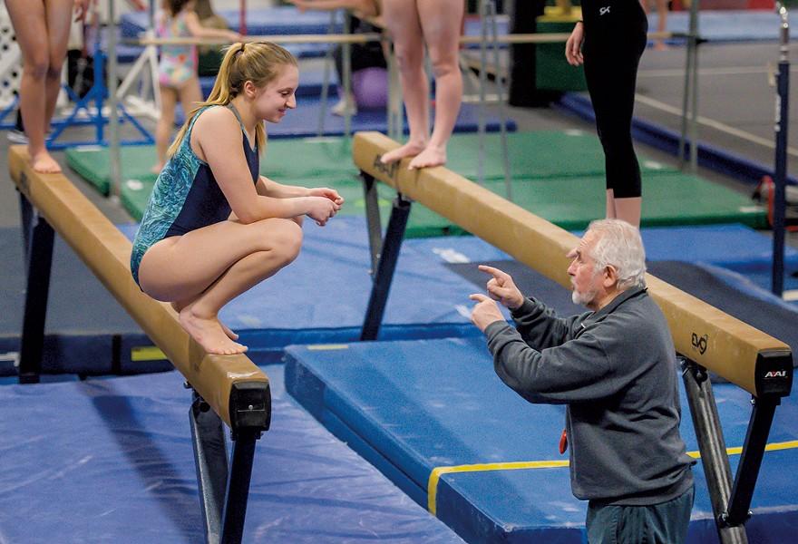 Hruska giving balance beam tips to gymnast Laurynn Bombardier - GLENN RUSSELL