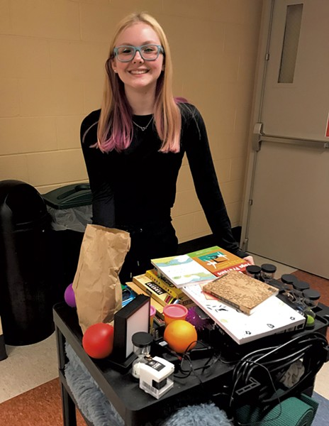 """Champlain Valley Union High School junior Maddie Evans with a """"stress-free"""" cart she designed for her Think Tank elective"""