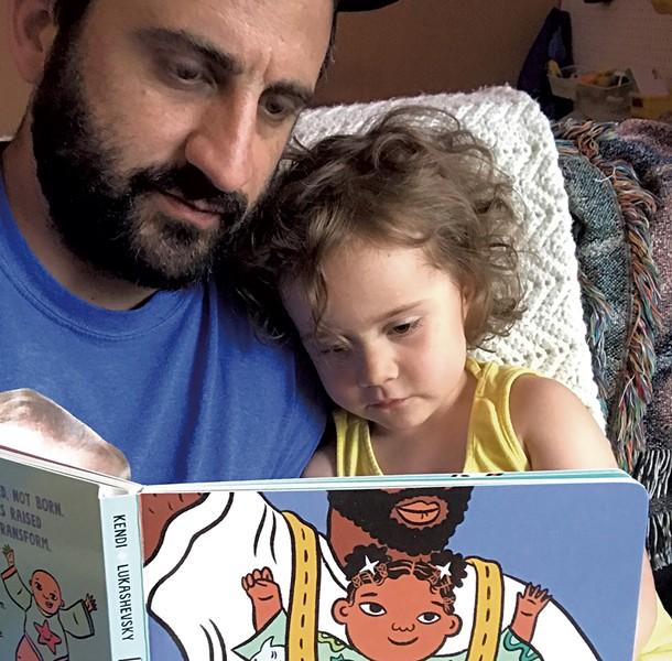 Keegan and Penelope reading Ibram X. Kendi's Antiracist Baby - KEEGAN ALBAUGH