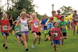 Kids take off at the start of Catamount's Tuesday Night Trail Running Series
