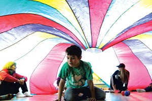Parachute play at Camp Kaleidoscope