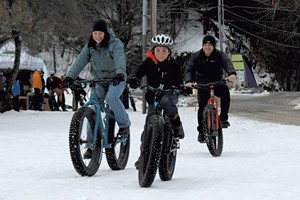 The Garbach family tries out fat bikes at the Überwintern festival in Stowe