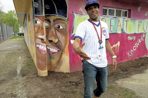 Barrino in front of his portrait on the mural in Roosevelt Park