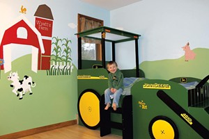 Wyatt Bogie at age 3, when his tractor bed was brand new