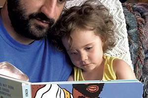 Keegan and Penelope reading Ibram X. Kendi's Antiracist Baby