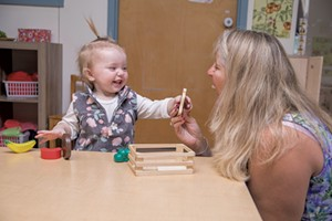 Learning to share in the Early Head Start classroom at Milton Family Community Center