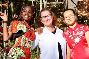 Teacher of the year Susan Rosato with students Steldie Mabiala (left) and Peas Liu