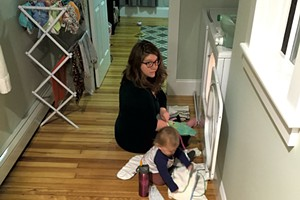 Meredith folding laundry with her daughter
