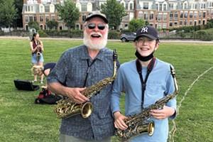 Craig Olzenak reunited with student Felix during the Burlington Discover Jazz Fest