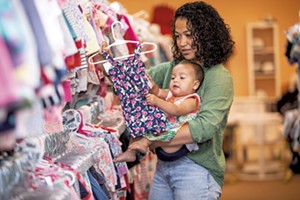 Maria Munroe and her 9-month-old daughter, Malia, shopping at Boho Baby