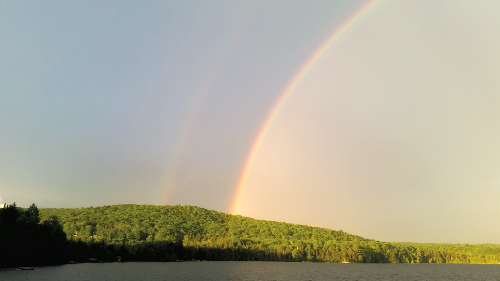 A rainbow over Caspian Lake - MOLLY RITVO