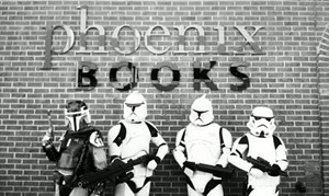 _under_outside_phoenix_books_sign_with_poses.jpg