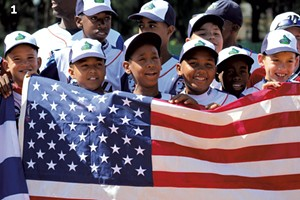 ALEXANDRE SILBERMAN - Players from Cuban team Playa hold the American flag