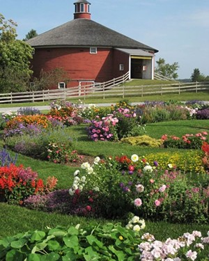 shelburne-musuem-round-barn-with-flowers-720x900.jpg
