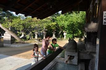 Washing hands at the Shinto shrine. - JESSICA LARA TICKTIN