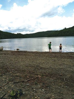 Will and Cullen Mezitt skip stones at Waterbury Reservoir