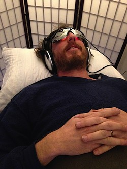 Ryan on the sound and light therapy table pre-float.
