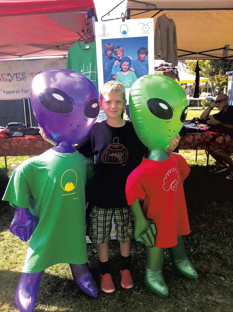 Wyatt selling his T-shirts at a summer market