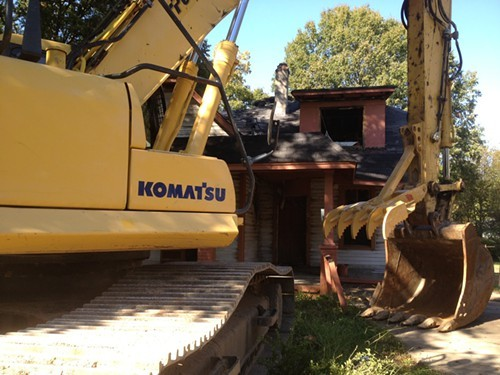 A backhoe prepares to demolish 746 Bullington.