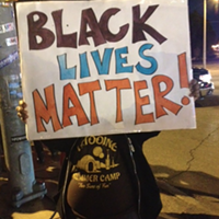 A protester near the intersection of Poplar and Highland.