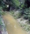 A recent photo of a muddy Lick Creek, near the V&E Greenline.