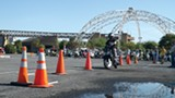 """A scooter makes its way through an obstacle course at the Dead Elvis Rally """"Kingkhana"""" competition. - ALEXANDRA PUSATERI"""