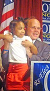 A victorious Cohen hoisting a young supporter