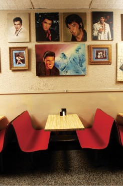 A wall of Elvis at Broadway Pizza - BY JUSTIN FOX BURKS