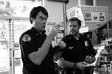 Affable cops Bill Hader and Seth Rogen