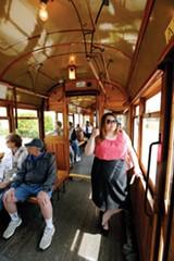 Alexandra Pusateri rides a trolley - JUSTIN FOX BURKS
