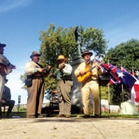 An old-time band plays some Confederate favorites during Saturday's rededication of the Jefferson Davis statue.