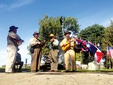 An old-time band plays some Confederate favorites during Saturday's rededication of the Jefferson Davis statue. - TOBY SELLS
