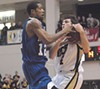 Antonio Anderson battles UCF's Mike O'Donnell.