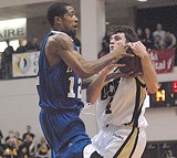 AP PHOTO - Antonio Anderson battles UCF's Mike O'Donnell.