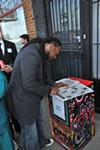 Artist Jamond Bullock reading the Flyer.